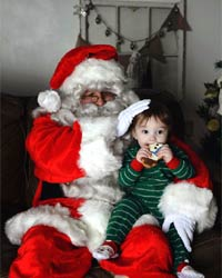 professional santa suit with boy eating cookie